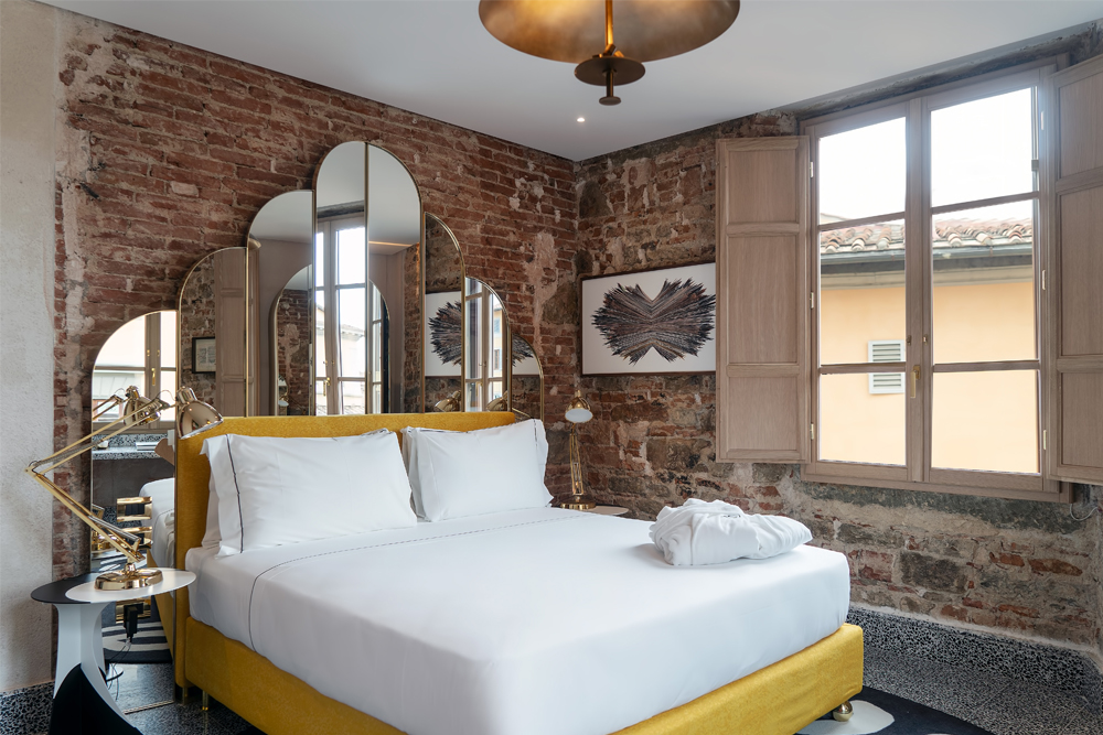 arredamento hotel calimala particolare del letto in una suite matrimoniale